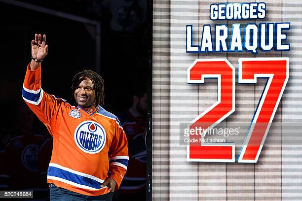 Former Oiler Georges Laraque is introduced during the closing ceremonies at Rexall Place following the game between the Edmonton Oilers and the...