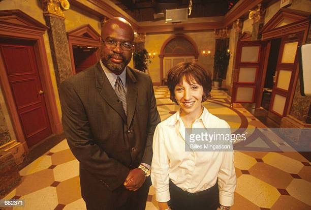 Former OJ Simpson prosecutor Christopher Darden poses with Executive Producer Jill Blackstone on the set of Fox TV's Divorce Court August 2000 in Los...