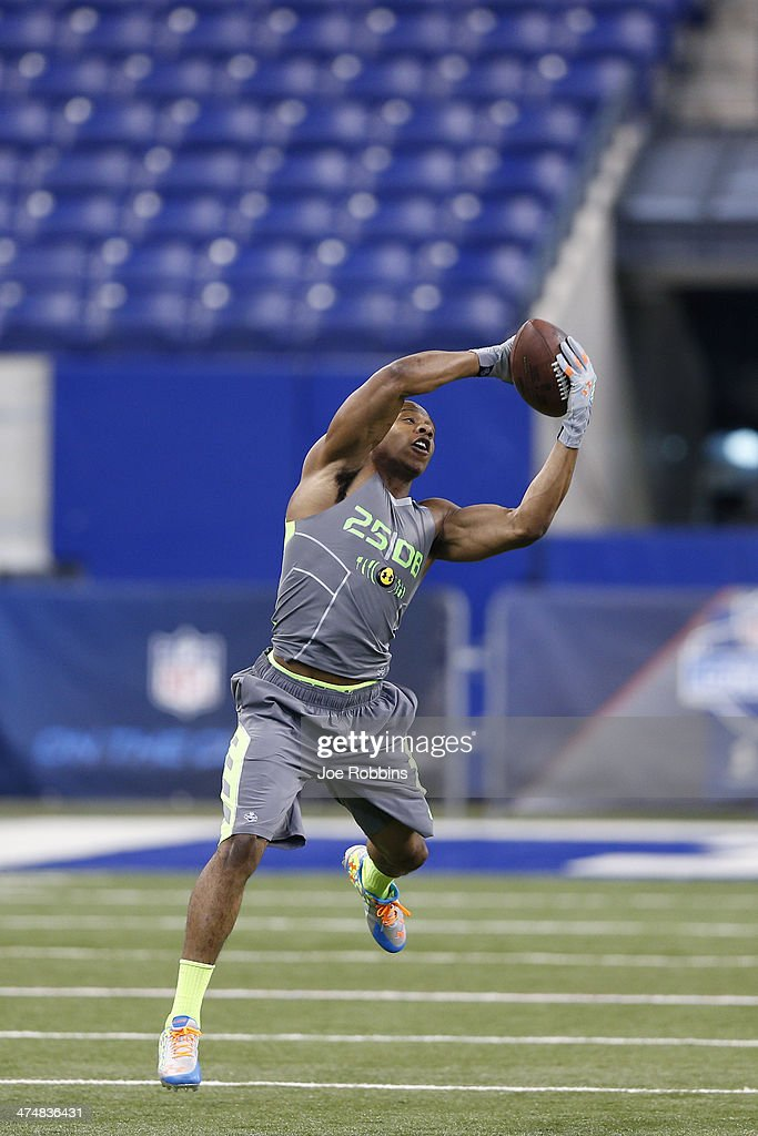 Former Oklahoma State defensive back Justin Gilbert catches the ball while running a drill during the 2014 NFL Combine at Lucas Oil Stadium on February 25, 2014 in Indianapolis, Indiana.