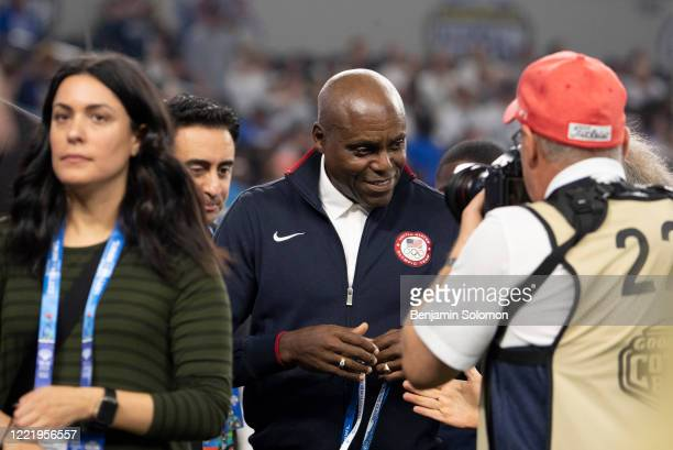 Former Olympian Carl Lewis is recognized on the field during the Goodyear Cotton Bowl Classic at ATT Stadium on December 28 2019 in Arlington Texas