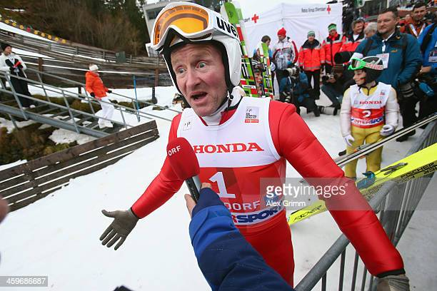Former Olympian Eddie 'The Eagle' Edwards attends a show jumping event on day 2 of the Four Hills Tournament Ski Jumping event at SchattenbergSchanze...