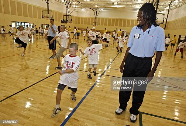 Former Olympian Katrina McClain directs a group of kids during a junior clinic sponsored by the NBA July 11 2007 at Nienhuis Park Community Center in...