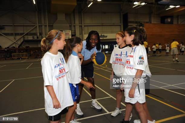 Former Olympian Katrina McClain explains a passing drill to campers at the Windsor area Jr NBA/Jr WNBA Pledge to Be a STAR Summer Camp at the...