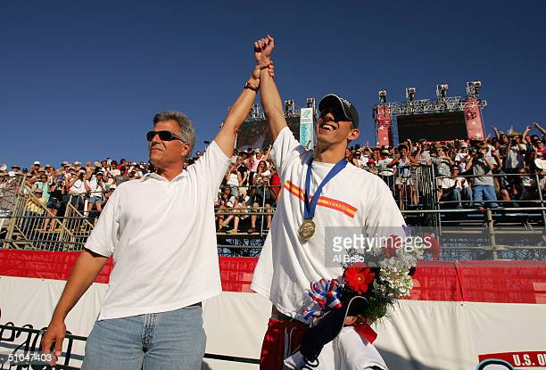Former Olympian Mark Spitz congratulates Michael Phelps on his win in the 200 meter butterfly final during the US Swimming Olympic Team Trials on...
