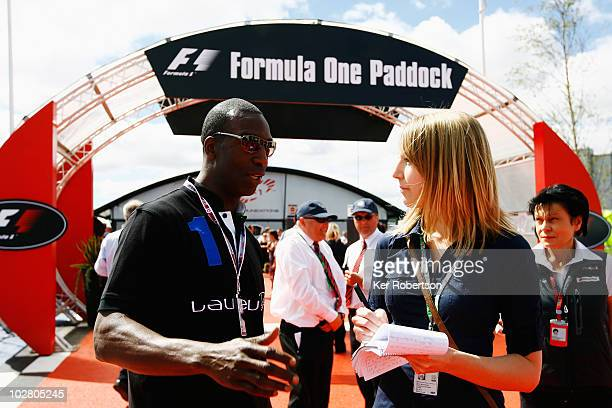 Former Olympic athlete Michael Johnson of the United States of America arrives in the F1 paddock before the British Formula One Grand Prix at...
