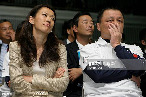 Former Olympic athletes Yuko Arimori and Mitsuo Nagatomo react as they receive the result of Tokyo being eliminated in the second ballot for the 2016...