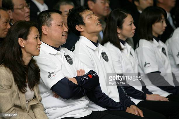 Former Olympic athletes Yuko Arimori Mitsuo Nagatomo Hisashi Mizutoshi Masami Tanaka and Kyoko Iwasaki react as they receive the result of Tokyo...