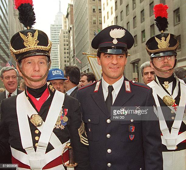 Former Olympic skiing champion Alberto Tomba of Italy dressed as a carabineer joins members of the color guard at the start of the Columbus Day...