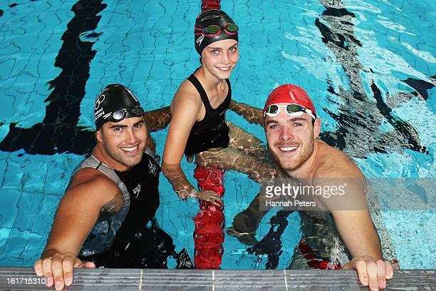 Former Olympic swimmer Moss Burmester Eva Williams and comedian Guy Williams pose for a photo during the Cure Kids 2013 Red Nose Day Launch at Mt...