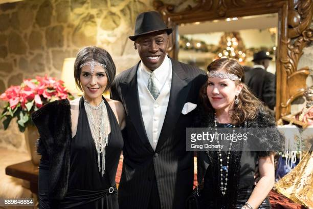 Former Olympic Triple Jump Gold Medalist Al Joyner and girlfriend Cindi and Actress Kira Reed Lorsch attend The Thalians Hollywood for Mental Health...