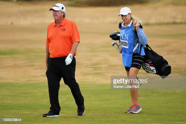 Former Open Champion Mark Calcavecchia of the United States walks down the 12th fairway while practicing during previews to the 147th Open...
