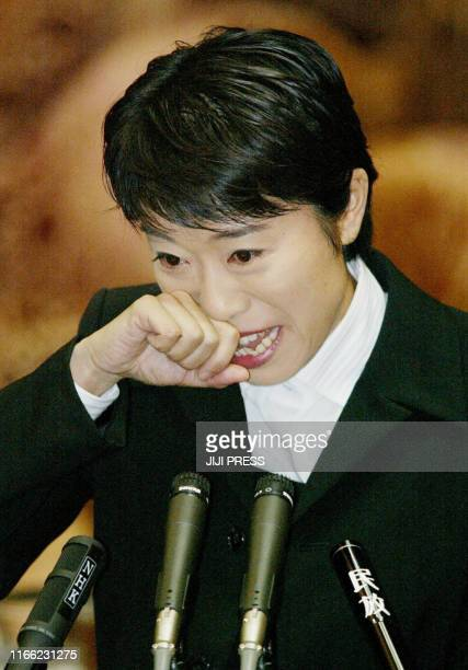 Former opposition lawmaker Kiyomi Tsujimoto who allegedly misused her secretaries' salaries sobs out during her testimony as an unsworn witness at...