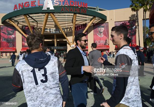 Former Orange Coast College player and coach Austin Wobrock greets members of the team coached by John Atlobelli as they attend a memorial service...