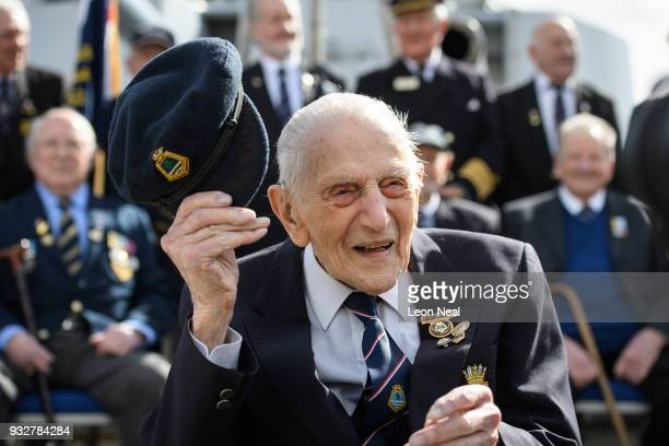 Former Ordance Artificer John Harrison aged 103 poses for photographs with a group of other veterans who also served aboard the HMS Belfast during an...