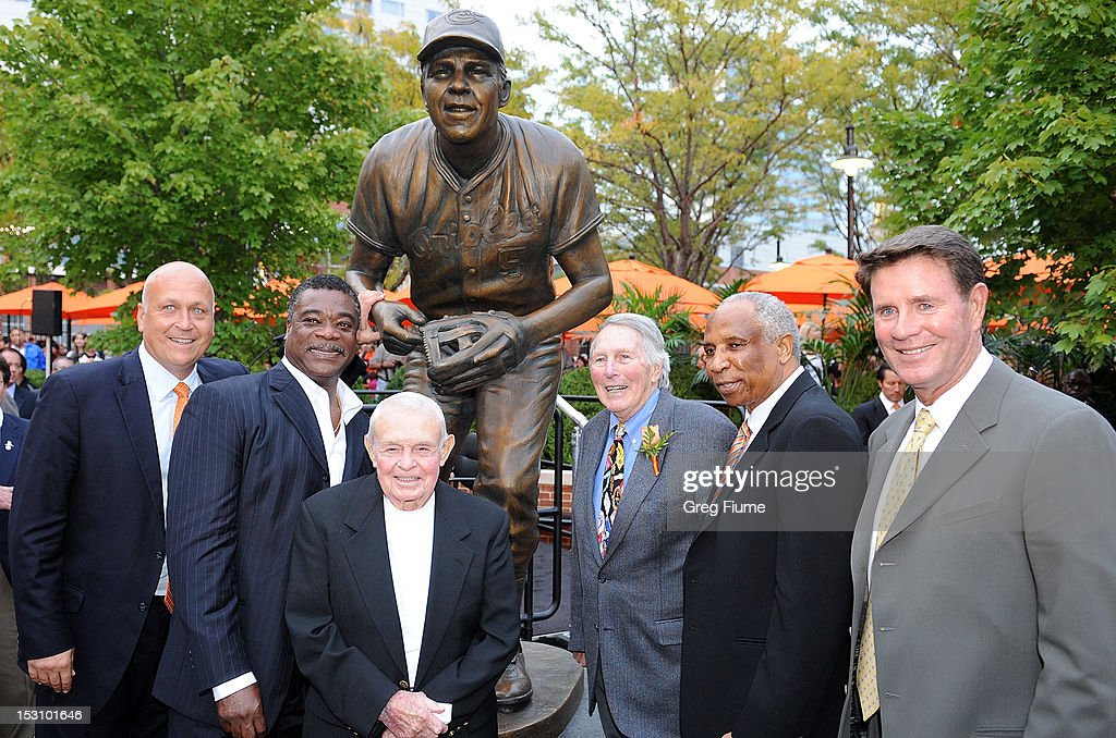 Former Oriole Brooks Robinson poses for photos with former Orioles Cal Ripken Jr., Eddie Murray, Earl Weaver, Frank Robinson and Jim Palmer at a ceremony in his honor before the game between the Baltimore Orioles and the Boston Red Sox at Oriole Park at Camden Yards on September 29, 2012 in Baltimore, Maryland.