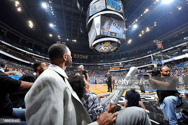 Former Orlando Magic player Tracy McGrady looks up at the bigscreen during the game against the New Orleans Pelicans on November 1 2013 at Amway...