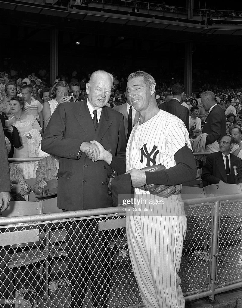 Former outfielder Joe DiMaggio, of the New York Yankees greets former United States President Herbert Hoover prior to Old Timer's Day in 1959 at Yankee Stadium in New York, New York.