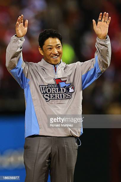 Former outfielder So Taguchi waves to the crowd prior to Game Four of the 2013 World Series between the Boston Red Sox and the St Louis Cardinals at...