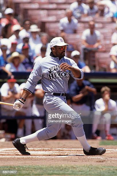 Former outfielder/designated hitter Reggie Jackson at bat during an exhibition game in 1992 at Anaheim Stadium in Anaheim California Reggie...