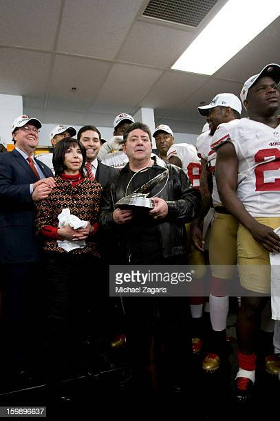 Former owner Eddie Debartolo of the San Francisco 49ers presents the George Halas Trophy to his sister and team CoChairman Denise York along nephew...