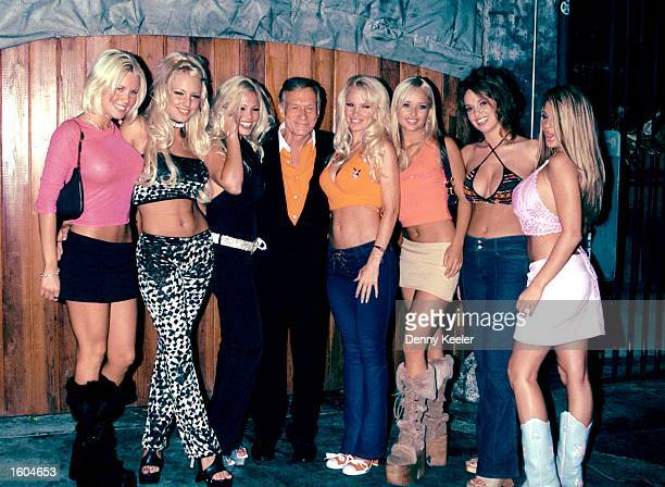 Former Page 3 girl Jordan right poses with Playboy founder Hugh Hefner and his playmates outside the Las Palmas Club July 25 2001 in Hollywood CA...