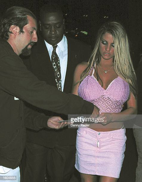 Former Page 3 girl Jordan right signs autographs as she and her bodyguard leave the Las Palmas Club July 25 2001 in Hollywood CA Jordan who''s real...