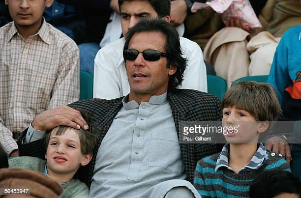 Former Pakistan cricket team captain Imran Khan and his sons Qasim and Suleiman Khan watch the action during the fourth one day international match...