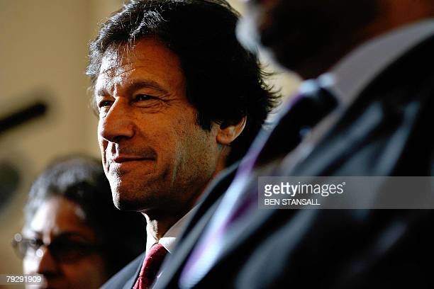 Former Pakistan cricketer and opposition leader Imran Khan attends a press conference at the Foreign Press Association in London, 28 January 2008, as...
