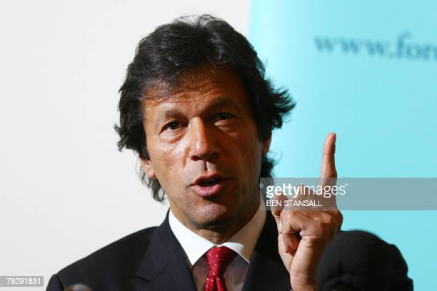 Former Pakistan cricketer and opposition leader Imran Khan speaks during a press conference at the Foreign Press Association in London, 28 January...