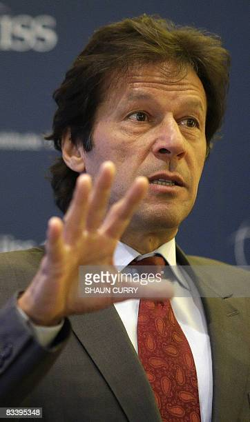 Former Pakistan cricketer and politician Imran Khan delivers a speech on 'the future of democracy in Pakistan' at the International Institute for...