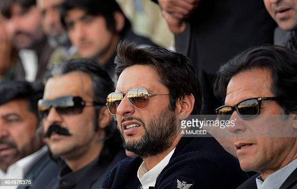 Former Pakistan cricketer turned politician Imran Khan and cricketer Shahid Afridi look on during the launch ceremony of a cricket talent search in...