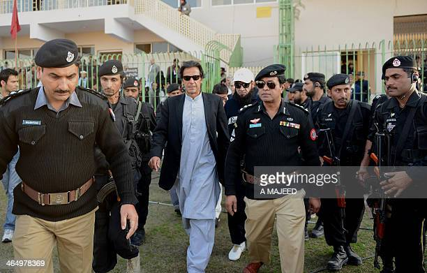Former Pakistan cricketer turned politician Imran Khan arrives at the launch ceremony of a cricket talent search in Peshawar on January 25 2014 Khan...