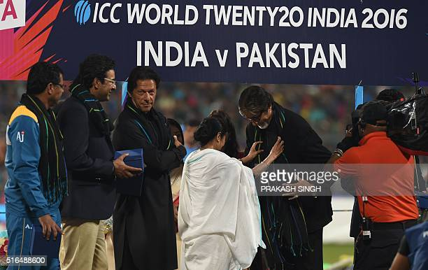 Former Pakistan cricketers Imran Khan,Wasim Akramand current Pakistan coach Waqar Younislook on as Indian Bollywood actor Amitabh Bachchanis...