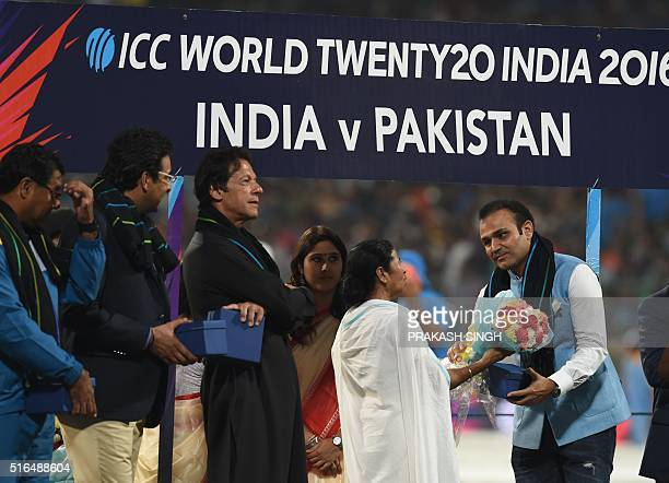 Former Pakistan cricketers Imran Khan,Wasim Akramand current Pakistan coach Waqar Younis look on as former Indian cricketer Virender Sehwagis...