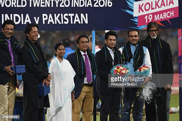 Former Pakistan cricketers Wasim Akramand Imran Khan pose with Chief Minister of the Indian state of West Bengal Mamata Bannerjeeand former Indian...