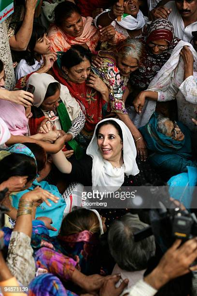 Former Pakistan Prime Minister Benazir Bhutto center visits the family home of Zaheer Abbas Bolas a Pakistan Peoples Party supporter killed in the...