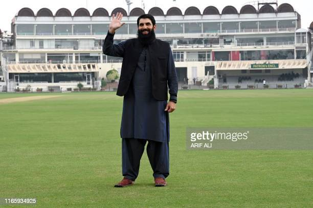 Former Pakistani cricket captain and newly appointed head coach of national cricket team Misbahul Haq poses for a photograph prior to his press...