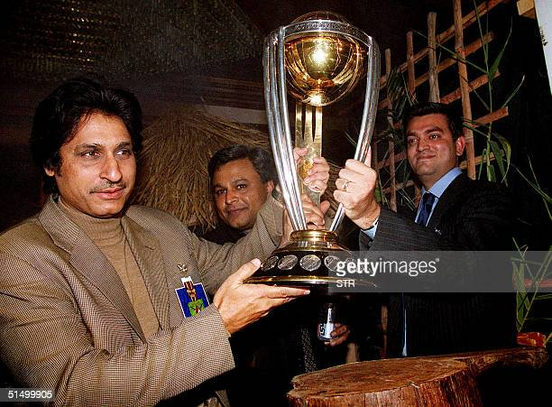 Former Pakistani cricketer and one of the member of 92 World Cup cricket squard Ramiz Raja holds ICC World Cup trophy during a ceremony at Murree...