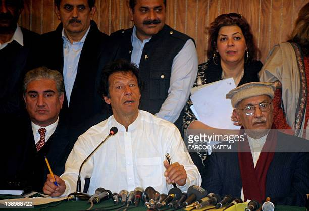 Former Pakistani cricketer turned politician Imran Khan and his party leader former foreign minister Shah Mehmood Qureshi address a press conference...