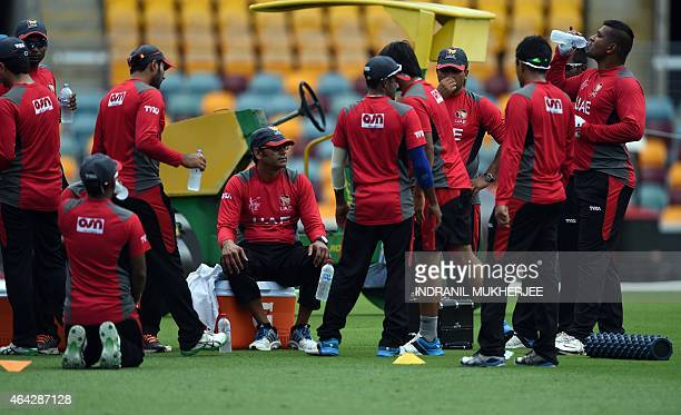 Former Pakistani fast bowler and United Arab Emirates coach Aaqib Javed looks on as cricketers take a break during a training session ahead of 2015...