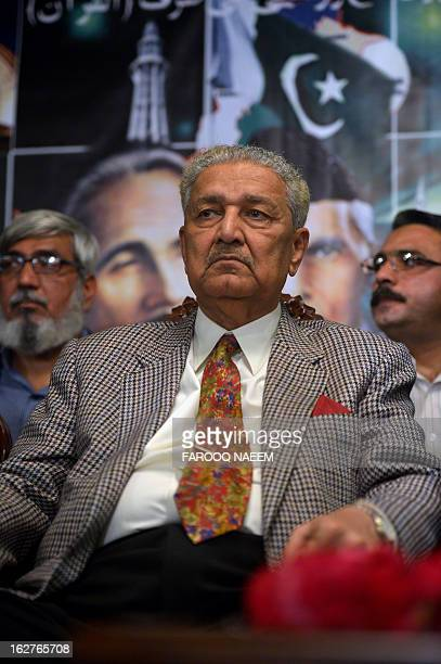 Former Pakistani nuclear scientist and chairman of TehreekeTahafuz Pakistan party Abdul Qadeer Khan sits during a public meeting along with members...