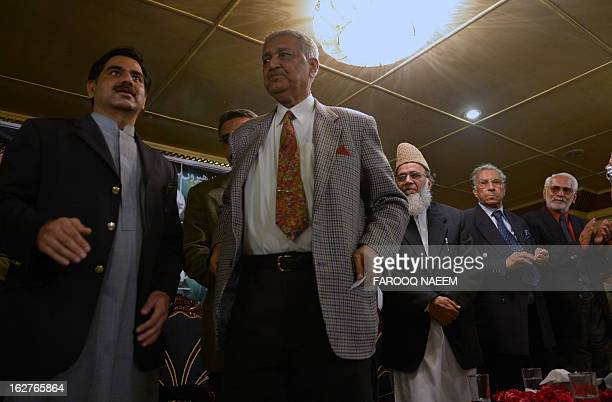 Former Pakistani nuclear scientist and chairman of TehreekeTahafuz Pakistan party Abdul Qadeer Khan stands to give a speech during a public meeting...