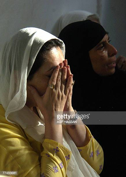Former Pakistani premier Benazir Bhutto prays in Karachi 21 October 2007 after the three days of mourning for those killed in a deadly suicide attack...