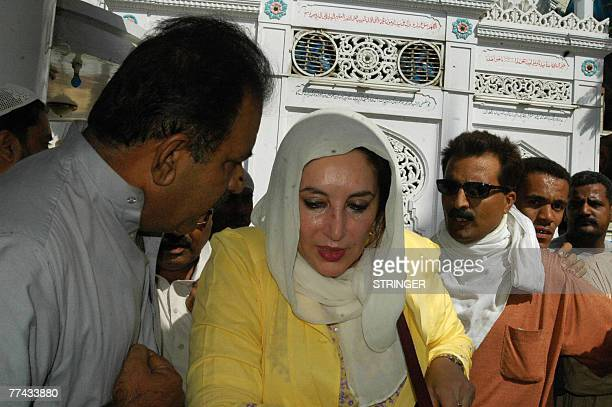 Former Pakistani premier Benazir Bhutto visits the Sayed Mohammad Shah Dulha Sabzwari shrine built by her father in Karachi 21 October 2007 after the...