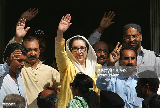 Former Pakistani premier Benazir Bhutto waves to supporters in Karachi 21 October 2007 after a visit to Jinnah hospital to offer support to some of...