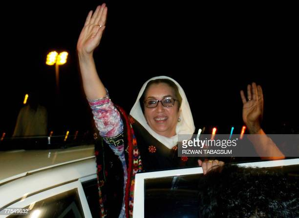 Former Pakistani premier Benazir Bhutto waves to supporters on her arrival at Jinnah international airport in Karachi 29 October 2007 Bhutto 29...