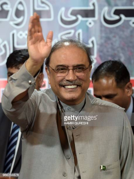 Former Pakistani president Asif Ali Zardari gestures as he arrives with party chairman of the Pakistan Peoples Party and his son Bilawal Bhutto...