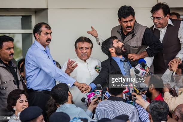 Former Pakistani president, Pervez Musharraf addresses a crowd supporters after landing on Pakistani soil at Jinnah International airport on March...
