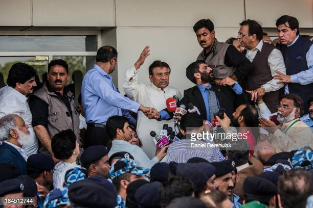 Former Pakistani president, Pervez Musharraf addresses a group of a few hundred supporters after landing on Pakistani soil at Jinnah International...