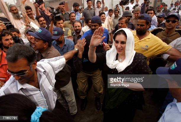 Former Pakistani Prime Minister and head of Pakistan People's Party Benazir Bhutto arrives at the village of a PPP supporter killed in the Karachi...